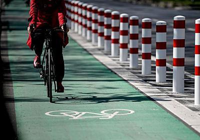 道路に「白線」だけの専用レーンでは、自転車をクルマから守れない:調査結果|WIRED.jp