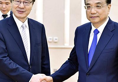 中国首相、日中関係改善に意欲 谷内局長と会談 首脳会談へ調整継続(写真=共同) :日本経済新聞