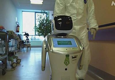 ロボットが患者の容体確認 医療従事者の感染防止で イタリア | NHKニュース