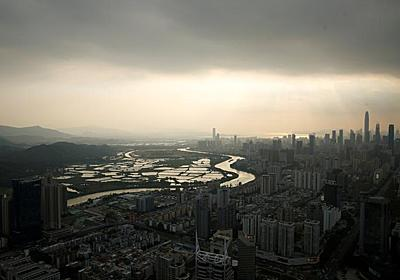 アングル:落日の香港、北部が深センの「裏庭化」 | ロイター