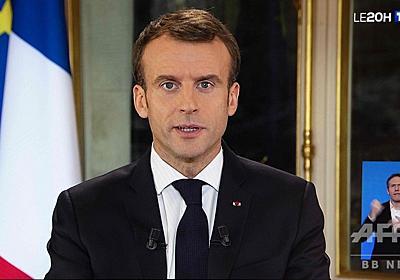 仏大統領、最低賃金引き上げを発表 デモ収束目指し演説 写真15枚 国際ニュース:AFPBB News