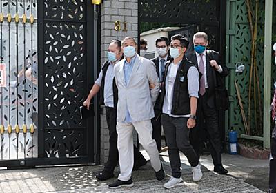 報道の自由奪われた香港、世界の金融センターとしての評判も失墜か - Bloomberg