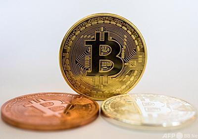 ビットコイン、初の6万ドル突破 写真4枚 国際ニュース:AFPBB News