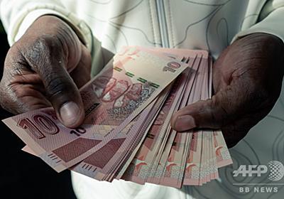 ジンバブエのインフレ率、840%近くに 政府は危機を否定 写真1枚 国際ニュース:AFPBB News