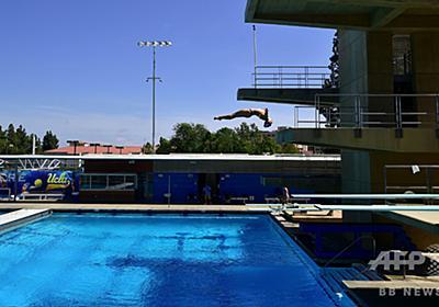 米女子水泳選手、肌の「露出過多」で失格 批判受け取り消しに 写真1枚 国際ニュース:AFPBB News