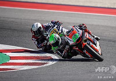 あわや惨事、Moto2ライダーが他選手のバイクのブレーキ握り失格に 写真2枚 国際ニュース:AFPBB News