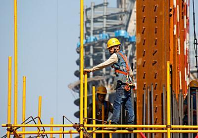 中国企業、ドル調達に苦戦 社債金利1年で2%上昇 (写真=ロイター) :日本経済新聞