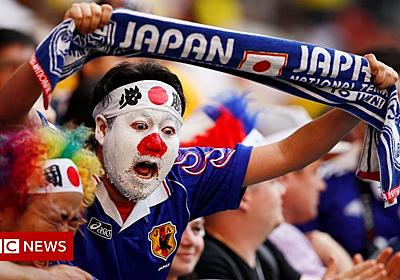 World Cup: Japan fans impress by cleaning up stadium - BBC News