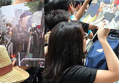 黒色に染まる「香港史上最大の200万人デモ」 延期方針後の日曜日、撤回求め - 毎日新聞