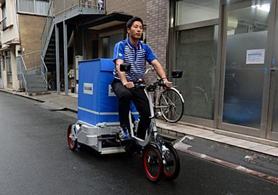 佐川急便、積み荷4倍のパワフル自転車 前輪に秘密  :日本経済新聞