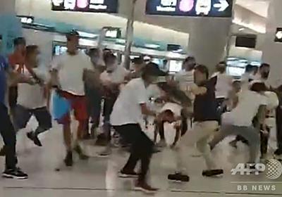 香港デモ参加者を白服集団が襲撃、45人負傷 三合会か、警察到着は1時間後 写真20枚 国際ニュース:AFPBB News