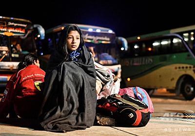 【記者コラム】戦争のない祖国から逃れる人々 写真17枚 国際ニュース:AFPBB News