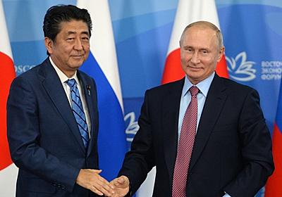 Putin offers Japan's Abe peace treaty by end of year without preconditions — RT World News