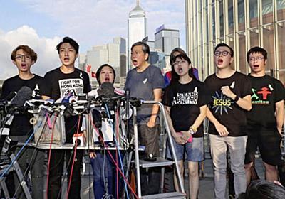 中国政府、香港政府の延期決定を支持 (写真=共同) :日本経済新聞