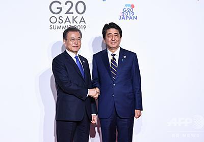韓国企業の会長が辞任、安倍氏を称賛し文氏を批判する動画めぐり 写真1枚 国際ニュース:AFPBB News