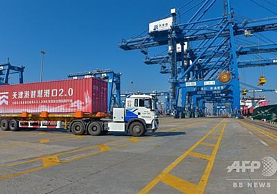 中国・天津港で無人化作業が実現 無人トラックや自動クレーン、ロボットが「活躍」 写真1枚 国際ニュース:AFPBB News
