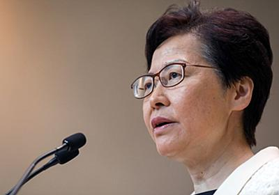 香港行政長官、逃亡犯条例改正案を正式に撤回-抗議活動収束は不透明 - Bloomberg